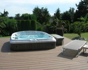 Outdoor hot tub installation on a deck.