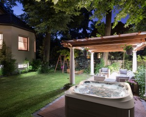 Backyard hot tub installation at night.